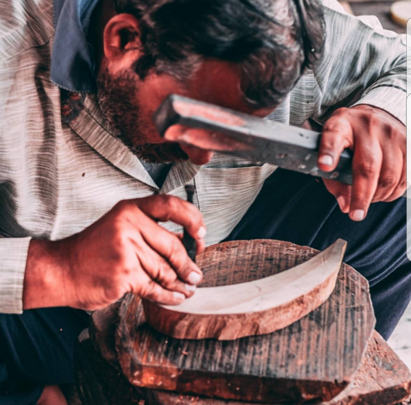 Man making wooden stamp for Bamboo Baby Blanket